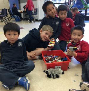 children playing with Legos in after-school program