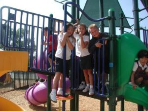 students playing outside on playground